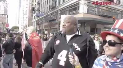 """God Bless Big Joe. Trump supporter sets the record straight to some protesters during the """"Women's March."""".. They swarmed Big Joe as a horde in hopes to silence him, but they soon would find out why they call Big Joe """"Big"""". Big Joe stands tall and true to his"""