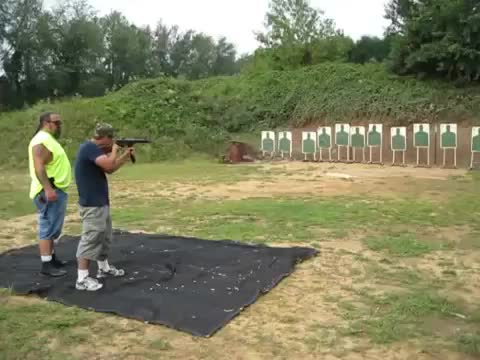 A little muzzle flash from the past. This was a custom M16 with a shorty barrel. I was just getting into Service Rifle competitions at the time here in my home